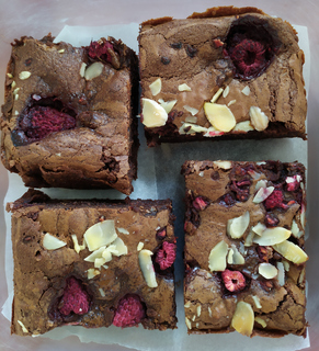 Pieces of raspberry and almond brownie