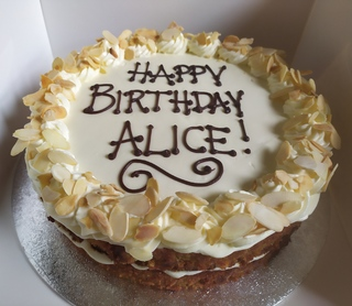 Orange and almond cake with writing