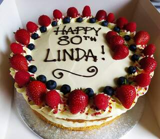 2-layer 10inch Victoria sponge with fresh berries, birthday message piped on