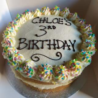 2-layer dairy-free Victoria sponge with colourful sprinkles, message piped on
