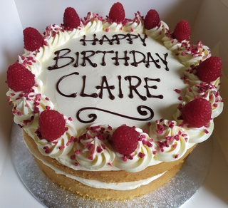 2-layer Victoria sponge with vanilla buttercream, fresh raspberries, message piped on top