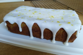 Lemon and poppy seed loaf with lemon icing dripping over the sides