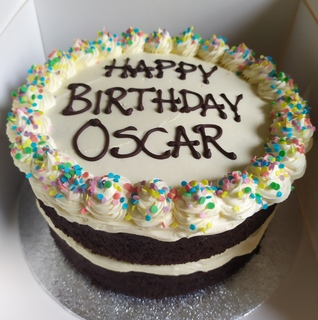 2-layer 8inch round dark chocolate cake with white chocolate buttercream, message piped on