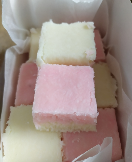 Box of pink and white coconut ice squares