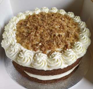 2-layer carrot cake with chopped walnuts on top