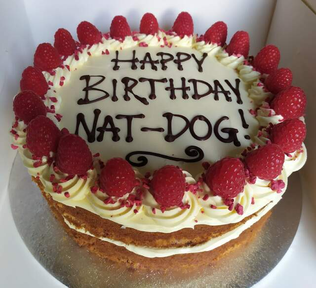 White chocolate and raspberry cake with writing 9in