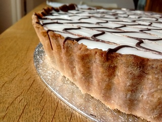 Close up of bakewell tart showing gluten free pastry