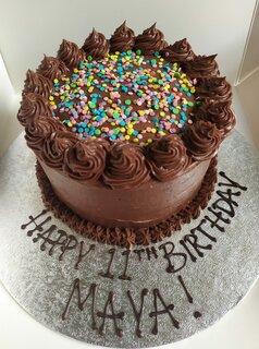 Vegan chocolate cake, writing on board 6in