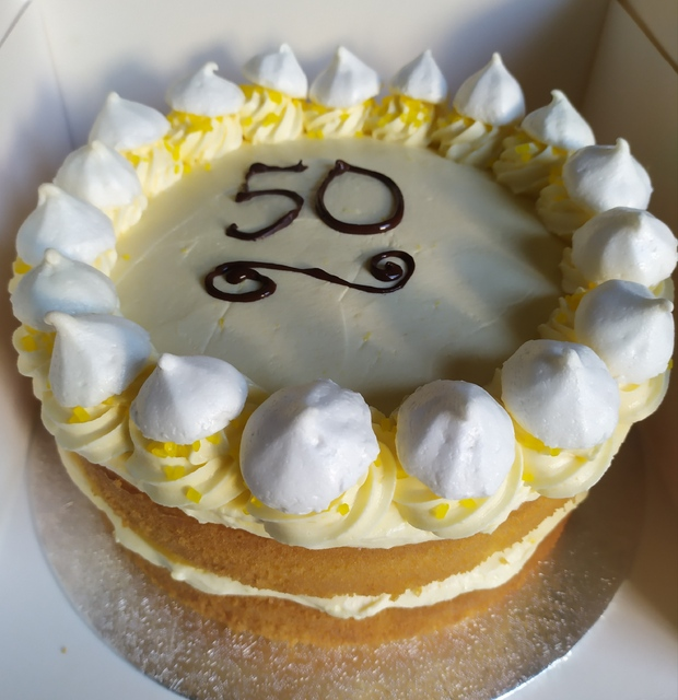 Lemon cake with writing with meringues 8in