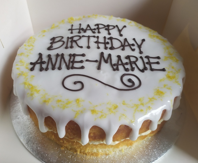 2-layer lemon drizzle cake, message piped on top