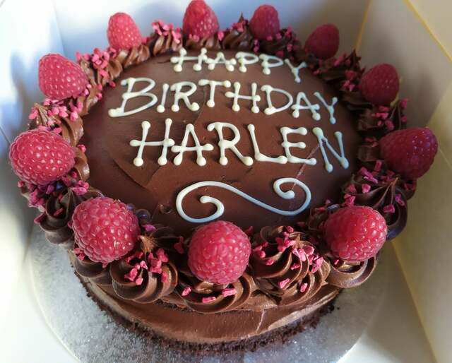 2-layer dairy-free chocolate and raspberry cake, message piped on top