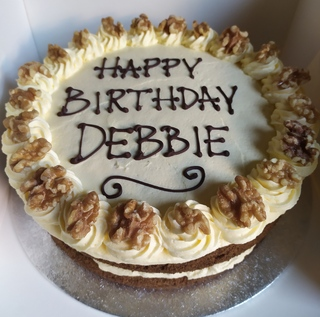 2-layer dairy-free carrot cake with vanilla buttercream, message piped on