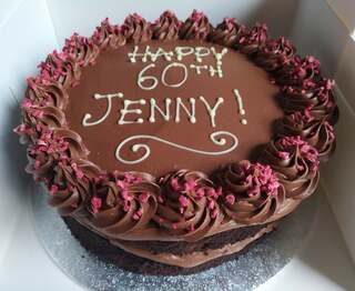 2-layer dairy-free chocolate and raspberrry cake, birthday message piped on