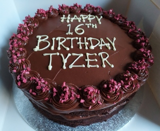 2-layer 9inch chocolate and raspberry cake, message piped on top