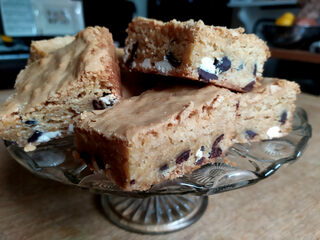 Plate full of blondies showing white and dark chocolate chips
