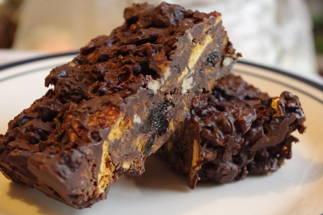 Chocolate tiffin slice showing honeycomb, nuts and sultana interior