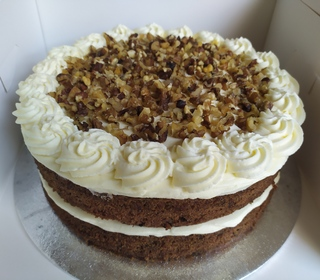 2-layer carrot cake with cream cheese icing and walnuts, no message on