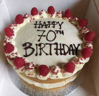 2-layer Victoria sponge with fresh raspberries, message piped on