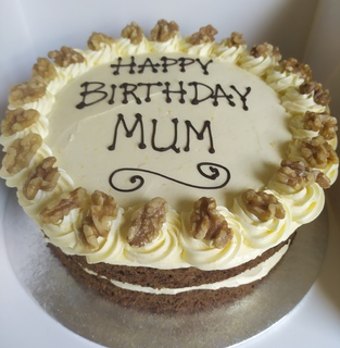 2-layer carrot cake with orange buttercream, birthday message piped on top