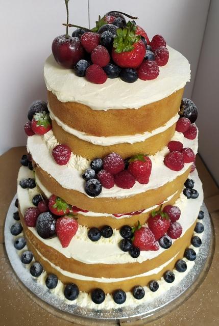 3-tier naked Victoria sponge with fresh berries