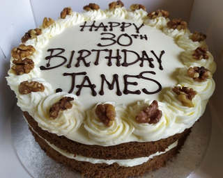 2-layer carrot cake with cream cheese frosting and a birthday message
