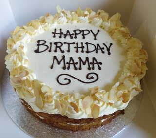 2-layer orange and almond cake with cream cheese icing, message piped on top
