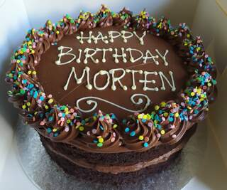 2-layer 8inch chocolate cake, message piped on