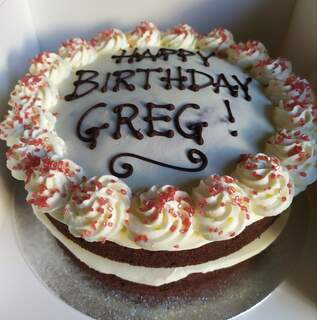 Red velvet cake with writing 8in